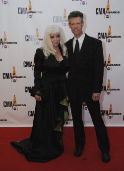 Randy Travis and Lib Hatcher arrive at the 43rd Annual CMA Awards in Nashville