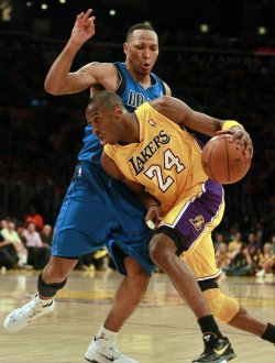 Los Angeles Lakers' Kobe Bryant drives around Dallas Mavericks Shawn Marion in the second half of Game 1 of the Western Conference semifinals in Los Angeles.