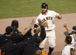 Giants Cody Ross gets congratulations after scoring against the Rangers in game two of the World Series in San Francisco