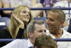 Kate Bock watches tennis at the US Open