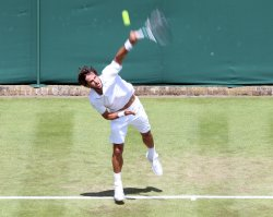 Spain's Feliciano Lopez serves on the second day at Wimbledon Tennis Championships