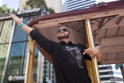 Giants Cody Ross waves to the fans during a massive parade in San Francisco