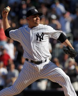 New York Yankees relief pitcher Alfredo Aceves throws a pitch at Yankee Stadium in New York
