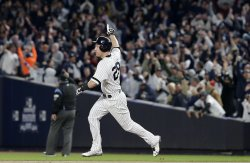Yankees Todd Frazier celebretas a home run in ALCS