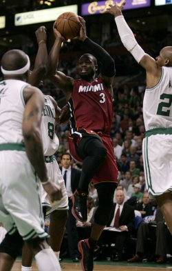 Heat Wade attempts shot against Celtics in Boston, MA.