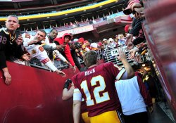 Redskins quarterback john Beck leaves the field in Maryland