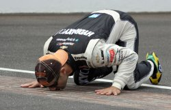 Tony Kanaan Kisses the Yard of Bricks at the Indianapolis 500