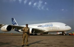 AN INDIAN POLICEMAN STAND GUARDS AN AIRBUS A380, AT INTERNATIONAL AIRPORT IN NEW DELHI
