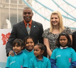 Carl Lewis poses with Rebecca Adlington