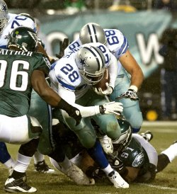 Dallas Cowboys Felix Jones plows through the Eagle defensives during first quarter,