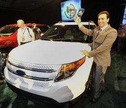 Fields stands with Ford Explorer at the 2011 NAIAS in Detroit