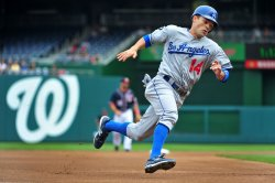 Dodgers Jamey Carroll rounds third as he goes for home in Washington