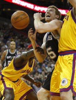 San Antonio Spurs Matt Bonner fouled by Warriors in Oakland, California
