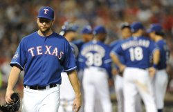 Texas' Feldman goes four innings against Yankees in Arlington