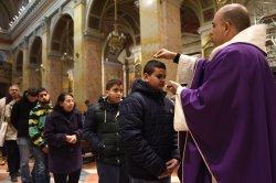 A Priest Sprinkles Ashes On Boy's Head On Ash Wednesday, Old City Of Jerusalem