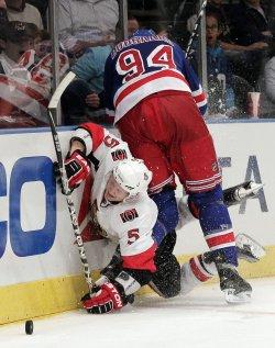 New York Rangers Derek Boogaard slams into Ottawa Senators Brian Lee at Madison Square Garden