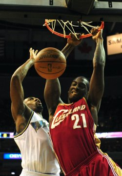 Cavaliers' J.J. Hickson dunks the ball in Washington