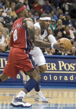 Nuggets Anthony Drives Against Nets Williams in Denver