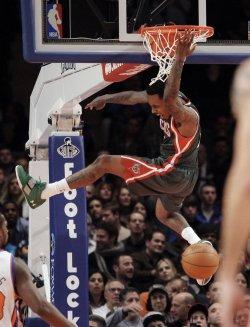 Milwaukee Bucks Brandon Jennings dunks at Madison Square Garden in New York