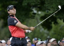 Jason Day hits a tee shot on the 4th hole at the PGA