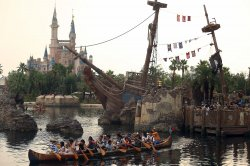 Chinese tourist paddle on a lake past in Shanghai Disneyland, China