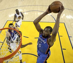 Oklahoma City Thunder's Kevin Durant goes in for a dunk