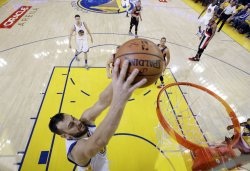 Warriors Andrew Bogut takes the ball to the basket