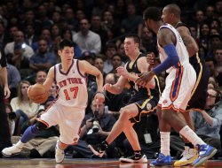 Indiana Pacers Tyler Hansbrough watches New York Knicks Jeremy Lin drive to the basket at Madison Square Garden in New York