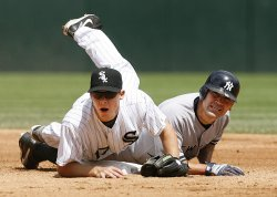 Chicago White Sox second baseman Chris Getz forces out New York Yankees' Johnny Damon