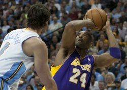 Lakers Bryant Scores Over Nuggets Gallinari During the NBA Western Conference Playoffs First Round Game Six in Denver