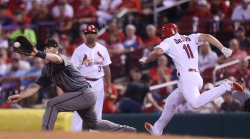 St. Louis Cardinals Paul DeJong out at first base