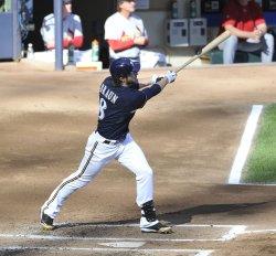 Brewers' Braun follows through on home run during NLCS in Milwaukee, Wisconsin