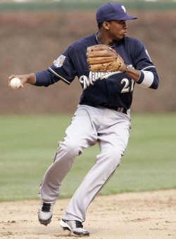 Brewers Shortstop Escobar Throws to First Against Cubs