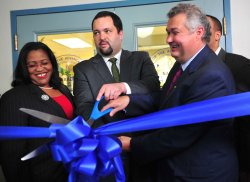 NAACP President and CEO Benjamin Todd Jealous, John Campbell, executive vice president of Social Responsibility at Wells Fargo and Georgette Dixon, Senior Vice President at Wells Fargo, participate in the ribbon cutting ceremony at the NAACP Financial Fre