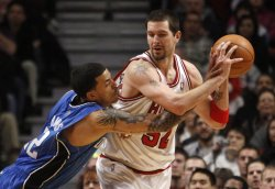 Bulls' Miller handles the ball as Magic's Barnes defends in Chicago