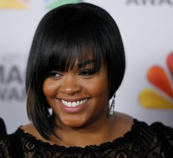 Recording artist Jill Scott arrives at the 43rd NAACP Image Awards in Los Angeles