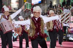 Women in white wigs perform in the 84th Annual Hollywood Christmas Parade in Los Angeles