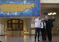 U2 unveil a tapestry honoring John Lennon in the presence of Yoko Ono
