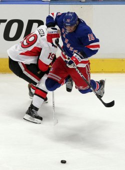 New York Rangers Marian Gaborik leaps over the stick of Ottawa Senators Jason Spezza at Madison Square Garden in New York