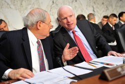 Sen. John McCarin (R-AZ) talks to Sen. Carl Levin during a hearing on Iraq security in Washington