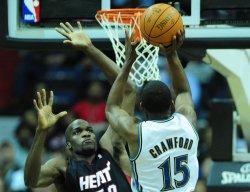 Wizards' Jordan Crawford shoots over Miami Heat's Joel Anthony in Washington