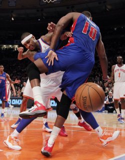 New York Knicks Carmelo Anthony and Detroit Pistons Tayshaun Prince get tangled up at Madison Square Garden in New York