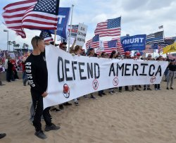 """Some 2,000 """"Make America Great Again"""" supporters march in Huntington Beach, California"""