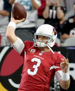Cardinals' Palmer throws to warm up