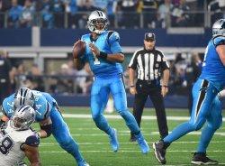 Panthers Cam Newton scrambles against the Dallas Cowboys