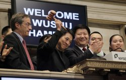 Actor Jet Li rings the Closing Bell at the NYSE on Wall Street in New York