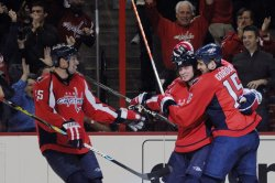 Capitals Bradley congratulated after scoring against Red Wings in Washington