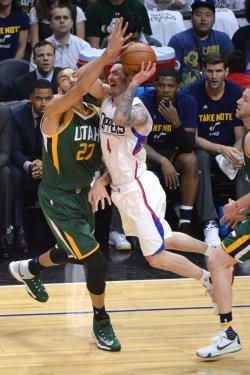 Clippers' guard JJ Reddick (4) has his pass blocked by Jazz center Rudy Gobert in Los Angeles