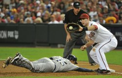 Hairston dives back to first in game three of the NLCS in Arizona.