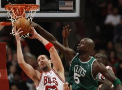 Bulls' Miller and Celtics' Garnett go for rebound in Chicago